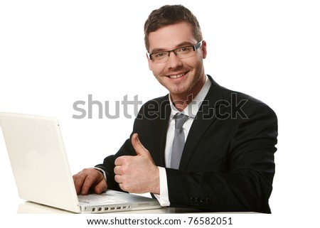 Young thoughtful business man working at the notebook with thumb up gesture