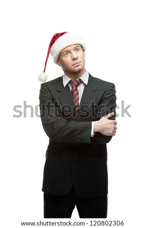 young thoughtful caucasian businessman in black suit and santa hat isolated on white