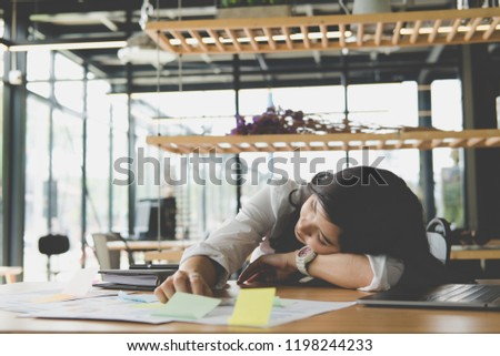 young tired businesswoman sleep at office. exhausted woman dozing at workplace. overwork, fatigue concept