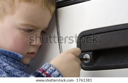 young toddler opening first car! - stock photo