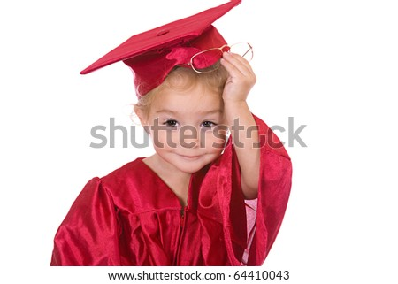 Young toddler scholar dressed in graduation cap and gown.