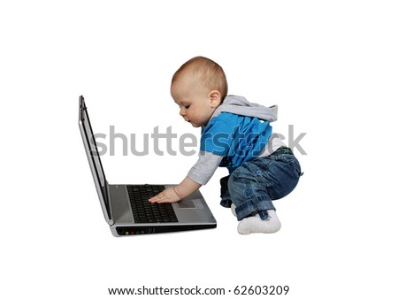 young toddler using a modern laptop