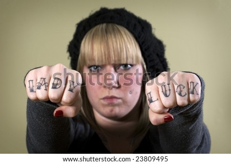 stock photo : Young tough girl with attitude and tattoo on knuckles
