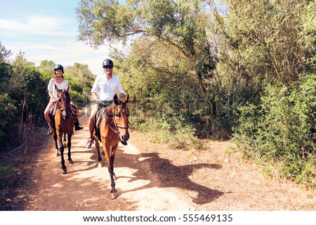 Shutterstock Young Tourist Couple Horseback Riding