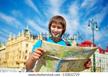 Young tourist couple with route maps looking for a way