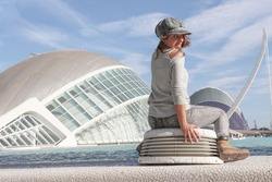 Young tourist female posing in front of a the beautiful building of Valencia