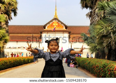 Young tourist girl is enjoying a visit at famous touristic sight in Luang Prabang, Laos #1509428570