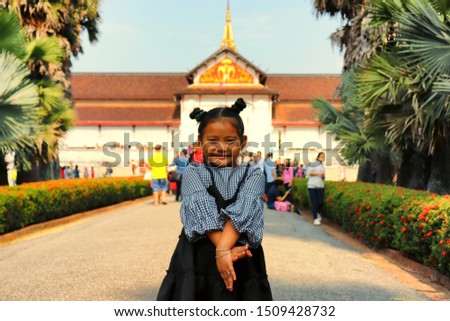 Young tourist girl is enjoying a visit at famous touristic sight in Luang Prabang, Laos #1509428732