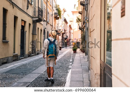 Young tourist man exploring the streets of Genova, Italy, Europe. Tourism concept #699600064