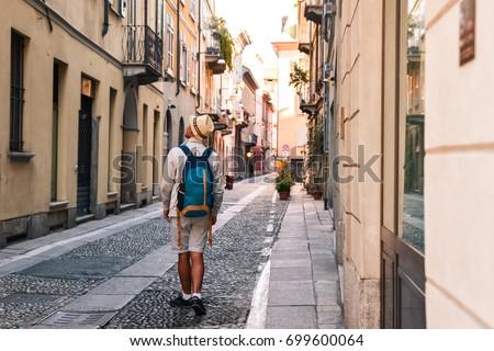 young tourist man exploring the ...