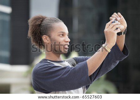Young tourist taking a self portrait