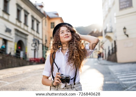 Young tourist with camera in the old town
