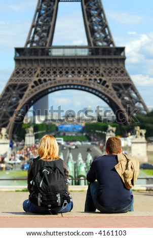 Young tourists enjoying the view of Eiffel tower in Paris, France.