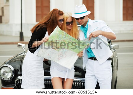 Young tourists with a map.