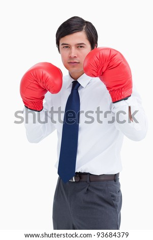 Young tradesman with boxing gloves against a white background