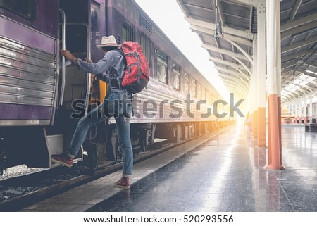 Young traveler with backpack in the railway. vintage effected photo. Travel concept