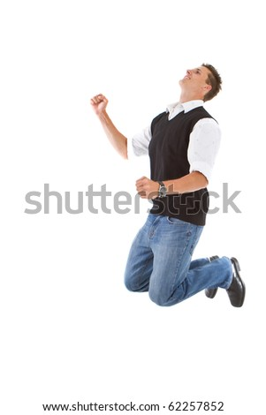 Young trendy stylish teenager jumping in joy isolated over white background.