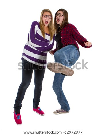 Young trendy teenagers in a nerd / geek style. Isolated over white background.
