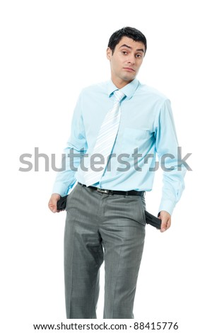 Young unhappy, sad and broke business man showing empty pants pockets, no cash, isolated over white background