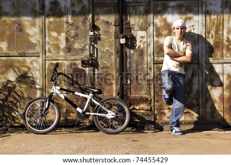 Young urban bmx rider - stock photo