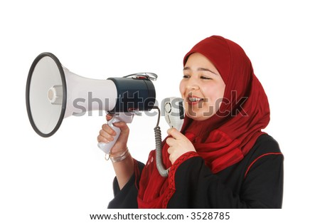 Young veiled woman protesting with use of a megaphone