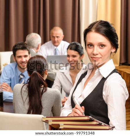 Young waitress hold menu business people have lunch at restaurant