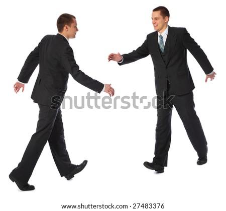 Young walking businessman going handshake