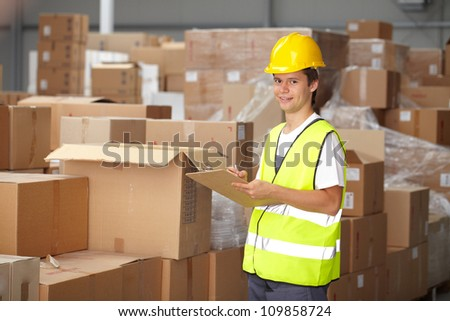 Young warehouse worker do some stock check