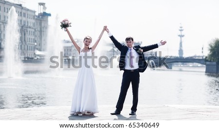 Young wedding couple. At the river bank.