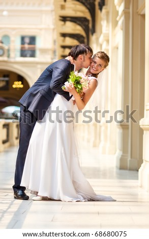 Young wedding couple indoors. Bright white colors.