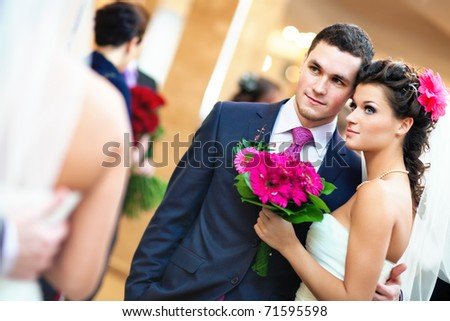 Young wedding couple looking at mirror.