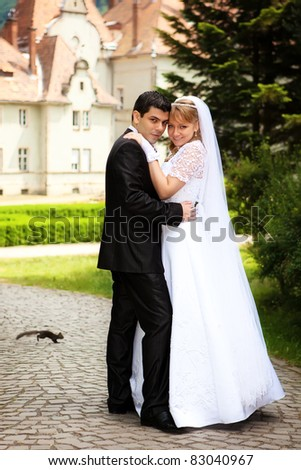 young wedding couple outdoors on their wedding day