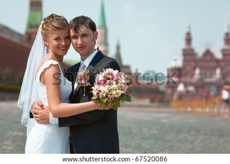 Young wedding couple portrait. On Red Square Moscow Russia.