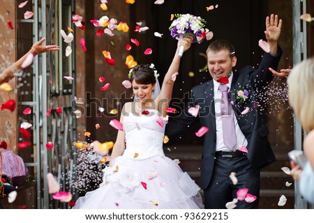Young wedding couple. Traditional coming out after marriage registration