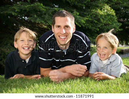 young white father and two boys outdoors