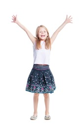 Young winner. Full length of happy young little girl celebrating, gesturing, keeping arms raised and expressing positivity. Isolated on white.