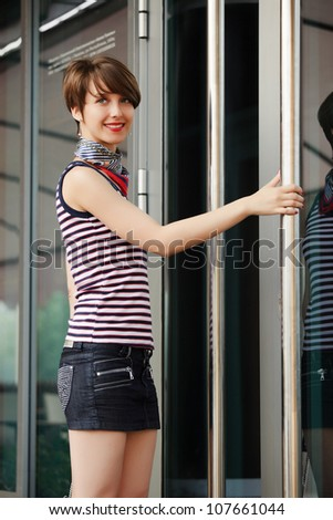 Young woman against a shop door