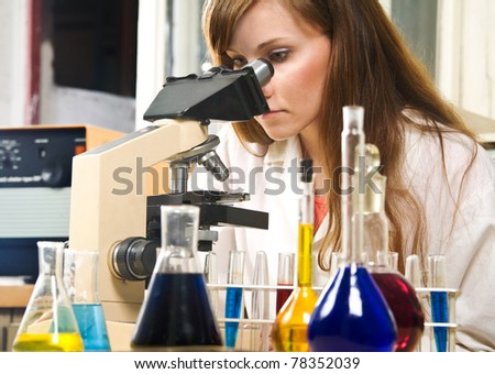 Young woman analyzing samples in a lab