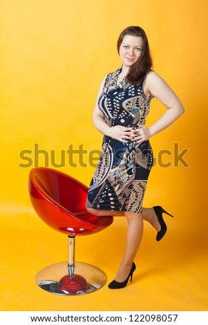 young woman and a red chair