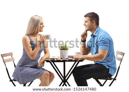 Young woman and a young man at a cafe isolated on white background