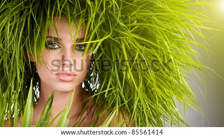 Young  woman and abstract green hair