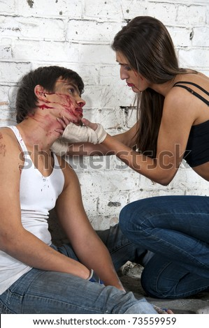 Young woman and beaten man after fight sitting on the floor