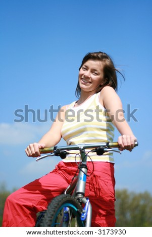 young woman and bike - break