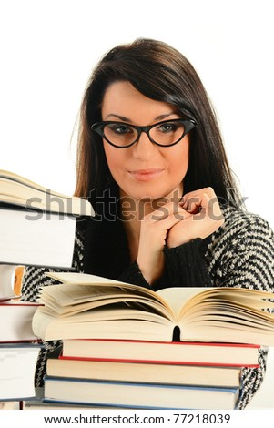 Young woman and books isolated on white. Female student learning