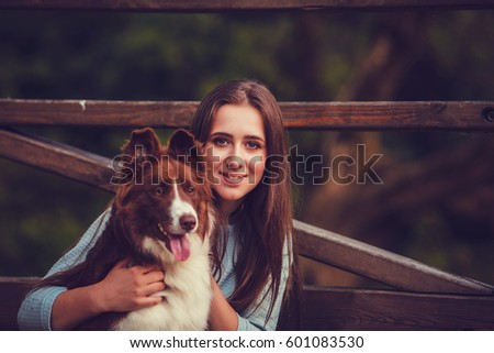 young woman and border collie...