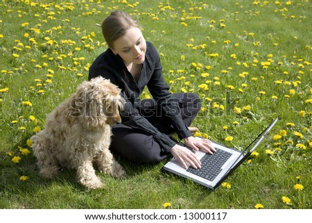 Young Woman And Dog Working On Computer Together
