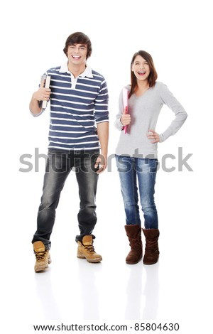 Young woman and man standing with books, isolated on white - stock photo