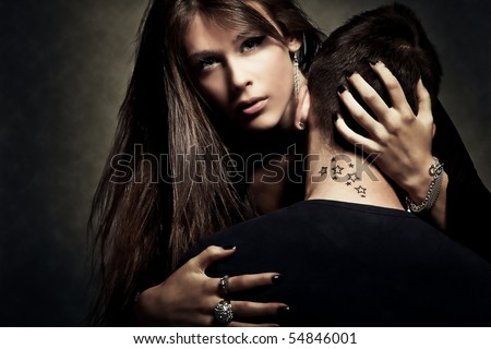 young woman and man  with  tattoo on neck - stock photo