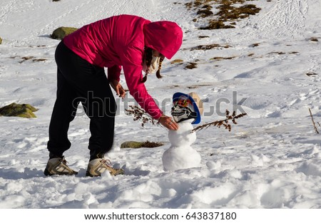 young woman and snowman