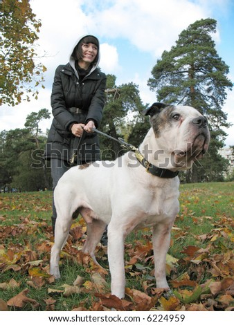 Young woman and strong dog